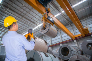 man moving materials in a warehouse setting