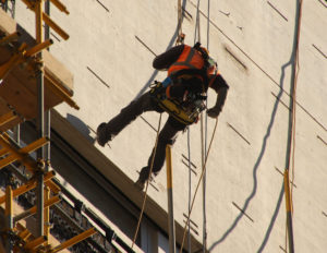 Man working at height with scaffolding