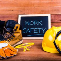 """work boots, gloves, helmet and sign that says """"Work Safety"""""""
